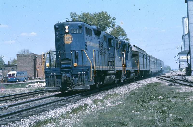 """The engineer eases back on the throttle and the """"Cannon Ball"""" glides into the station.  The Porter and Conductor have the vestibule doors open and the steps are down.<br /> (Photo by William A. Shaffer)"""