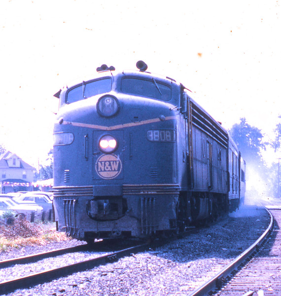 N&W #3008 is shown with a northbound passenger train as it passes Millikin University.<br /> (Photo by William A. Shaffer)