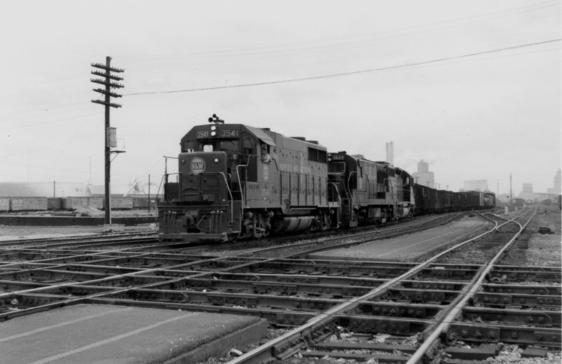 N&W #3541 is shown as it prepares to cross the Illinois Central Railroad at Wabic Tower in Decatur, IL.<br /> (Photo by William A. Shaffer)