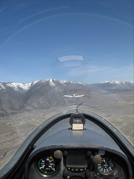 If you look just above the  cockpit you can see the plane towing the glider I'm in.  The plane towed us up to 11000 feet, then we released the tow line and glided around on our own for about an hour.  It was quite an experience.  Thats the Sierra mountains you see, just over the other side is Lake Tahoe.