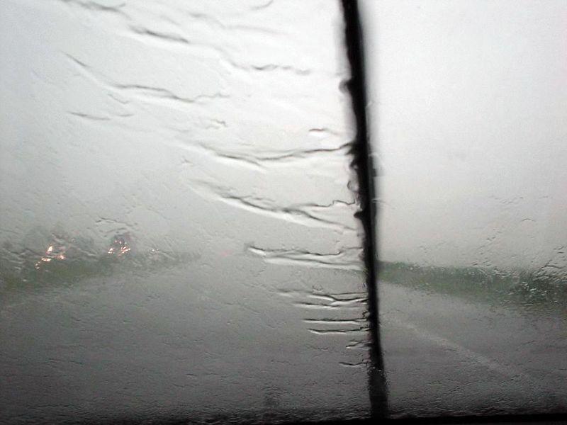 HEAVY rain shower, taken through the windshield