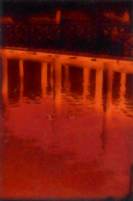 Piers reflected in water - very small prints only