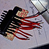 "AMR1173 adaptor - needed to solder extended leads because the ""pigtail"" leads were not long enough to facilitate soldering to the pin-outs of the adaptor through the back of the casing that will hold the adapter.<br /> <br /> Not shown is how I prepared the casing for the adapter, basically I drew a line around the casing 28mm from the back of the original AMR1173 casing, then I used the Dremel tool to cut the casing to size, then I drilled a 13mm hole in the back of the casing, you can just see the finished casing on the right."