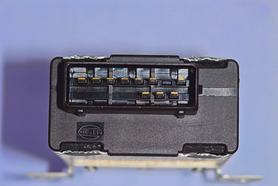 AMR1173 ECU with the four flaps raised to allow removal of the black plastic cover - just slide the front cover out.