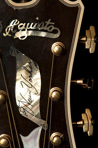 "A rare 1978 D'Aquisto head piece with pearl inlays on the New Yorker, 17-inch arch top guitar with brass strings.  Under 300 of this particular guitar were ever made, making it worth around 70 to $80,000 at current time.  D'Aquisto guitars were played by musicians such as Paul Simon and Joe Pass.  The owner of this guitar noted how D'Aquisto was a master at ""bringing out the sound,"" distinguishing it from other custom made guitars."