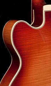"""A rare 1978 D'Aquisto New Yorker, 17-inch arch top guitar with brass strings.  Shown here is the Maple back.  Under 300 of this particular guitar were ever made, making it worth around 70 to $80,000 at current time.  D'Aquisto guitars were played by musicians such as Paul Simon and Joe Pass.  The owner of this guitar noted how D'Aquisto was a master at """"bringing out the sound,"""" distinguishing it from other custom made guitars."""