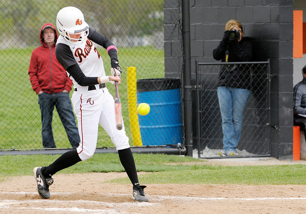 Don Knight | The Herald Bulletin<br /> Anderson University's Nichole Frazier hits a home run as the Ravens faced Transylvania during the HCAC tournament on Friday.