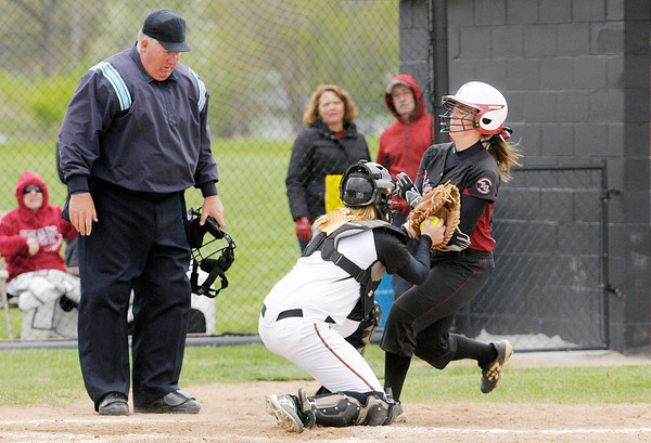 Don Knight | The Herald Bulletin<br /> Anderson University's Blake Thomas tags Transylvania's Lauren Willett out at home as the Ravens hosted the HCAC tournament on Friday.