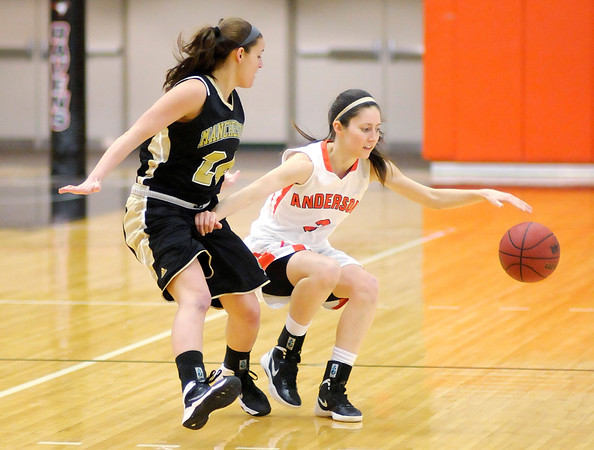 Don Knight / The Herald Bulletin<br /> Anderson's Kassidy Muntz brings the ball down court as she is guarded by Manchester's Alyssa Smith on Wednesday.