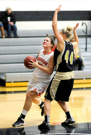 Don Knight / The Herald Bulletin<br /> Anderson's Cori Conner looks to shoot as she is guarded by Manchester's Erynn Meiklejohn on Wednesday.