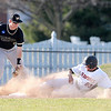 Don Knight | The Herald Bulletin<br /> Anderson University's Jocob Craft slides safely into third after a failed attempt to pick him off at first base on Tuesday.