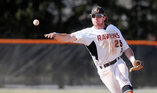 Don Knight | The Herald Bulletin<br /> Anderson University second baseman Chad Kirkpatrick throws to first after fielding the ball as the Ravens hosted Manchester on Tuesday.