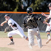 Don Knight | The Herald Bulletin<br /> Anderson University shortstop Connor Morris steps on second to force  Manchester's Derek Lamle out at second and throws to first to complete a 6 - 3 double play on Tuesday.