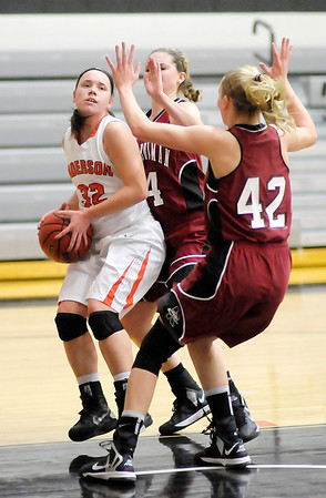 Anderson's Jenna Wittenberg moves into the paint against Rose Hulman's Andi Evers (24) and Gracie Gibbs (42) on Wednesday.