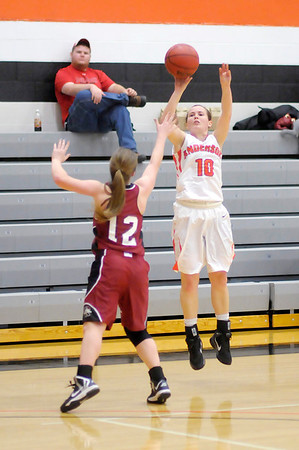 Anderson's Ashley Wuestefeld shoots from three-point range as she is guarded by Rose Hulman's Cassidy Cain on Wednesday.