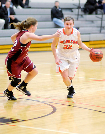 Anderson's Amy Wuestefeld drives as she is guarded by Rose Hulman's Cassidy Cain on Wednesday.