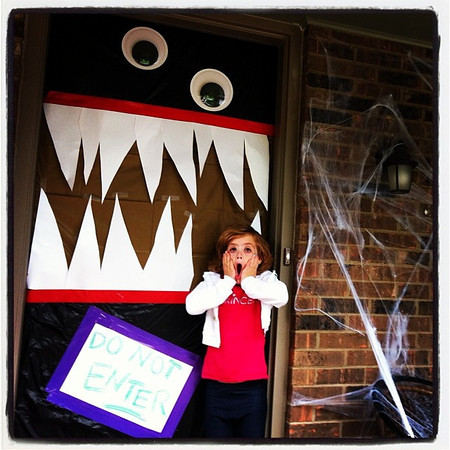 Lucy's Halloween door decorations give her a scare.<br /> <br /> Photographer's Name: Kim Williams<br /> Photographer's City and State: Anderson, Ind.