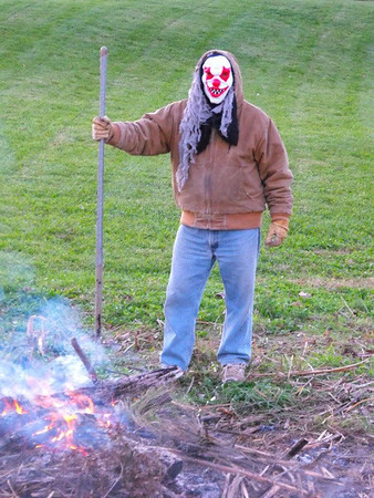 """""""Only you can prevent clown fires:"""" Getting ready for the Halloween bonfire in Richland Township.<br /> <br /> Photographer's Name: J.R. Rosencrans<br /> Photographer's City and State: Alexandria, Ind."""