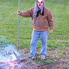 """Only you can prevent clown fires:"" Getting ready for the Halloween bonfire in Richland Township.<br /> <br /> Photographer's Name: J.R. Rosencrans<br /> Photographer's City and State: Alexandria, Ind."