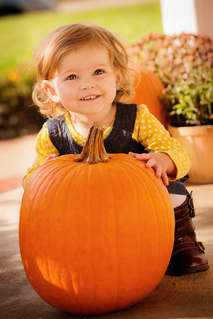 My granddaughter Aislynn Ayers enjoying a pumpkin.<br /> <br /> Photographer's Name: Terry Lynn Ayers<br /> Photographer's City and State: Anderson, Ind.