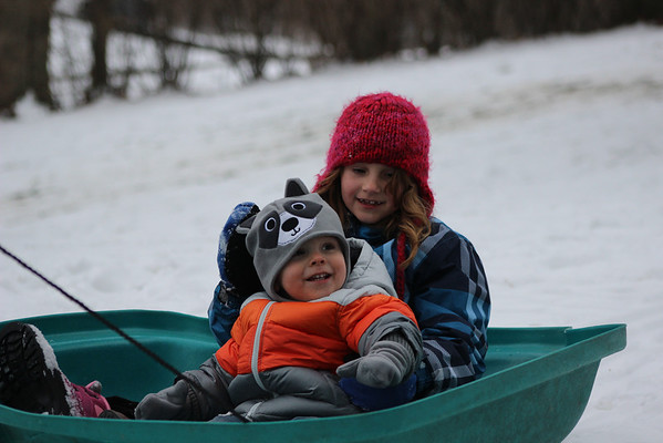 Grandchildren Jett and Leah sledding in our yard.<br /> <br /> Photographer's Name: Jerry Carignan<br /> Photographer's City and State: Anderson, Ind.