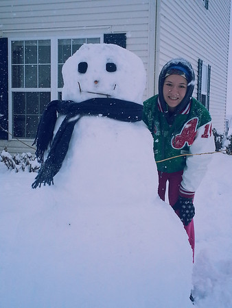 Serina Stinson and her snowman.<br /> <br /> Photographer's Name: Yolanda Stinson<br /> Photographer's City and State: Anderson, Ind.