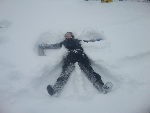 Kendra McCord making snow angels in her driveway. <br /> <br /> Photographer's Name: Lena McCord<br /> Photographer's City and State: Anderson, Ind.