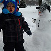 Our great-grandson Evan Lee Wright helping build his snowman.<br /> <br /> Photographer's Name: Shirley Alexander<br /> Photographer's City and State: Anderson, Ind.