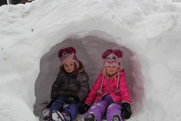 Indiana and Austin Dundas in their snow house carved from a pile of snow plowed off their driveway.<br /> <br /> Photographer's Name: Brittany Dundas<br /> Photographer's City and State: Anderson, Ind.