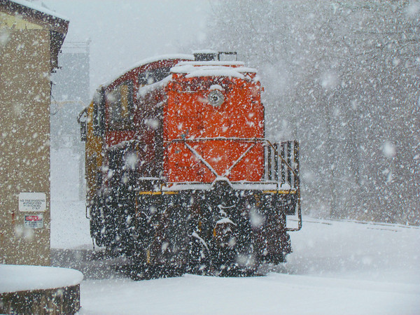 Orange train in the white snow.<br /> <br /> Photographer's Name: Brian Fox<br /> Photographer's City and State: Anderson, Ind.