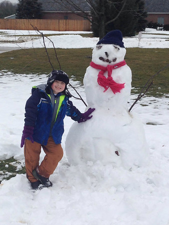 Our grandson Gavin, proud of his snowman he made with some help from Grandpa.<br /> <br /> Photographer's Name: Jerilyn Davis<br /> Photographer's City and State: Anderson, Ind.