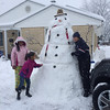 Robbie the snowman, built during the first snowstorm of 2014.<br /> <br /> Photographer's Name: Joy Ulm<br /> Photographer's City and State: Pendleton, Ind.