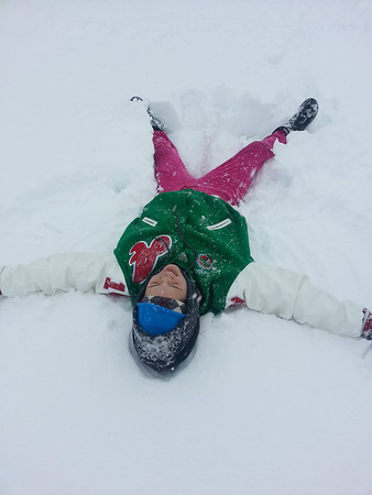 Serina making a snow angel.<br /> <br /> Photographer's Name: Yolanda Stinson<br /> Photographer's City and State: Anderson, Ind.