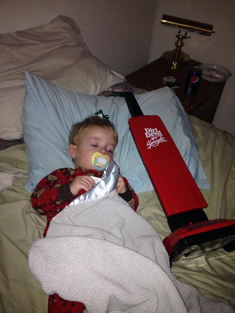 Landon loving the sweeper Santa brought him.<br /> <br /> Photographer's Name: Paula Hines-Spradlin<br /> Photographer's City and State: Anderson, Ind.