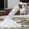When Art Tate built this snowman Friday afternoon, for his neighbors at CrownPointe, it was vertical. Saturday morning, both the snowman and Art were leaning....hopefully toward Spring.<br /> <br /> Photographer's Name: Art Tate<br /> Photographer's City and State: Anderson, IN