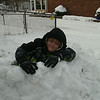 Our grandson Natan visiting from Arkansas building a snow fort.<br /> <br /> Photographer's Name: Karen Whitacre<br /> Photographer's City and State: Anderson, Ind.