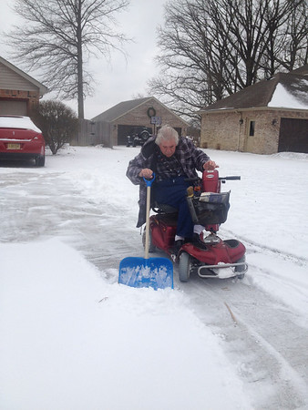 Lowell Butz (disabled Vietnam nam vet) won't let his disability get in the way of shoveling snow <br /> <br /> Photographer's Name: Pam Butz<br /> Photographer's City and State: Anderson, IN