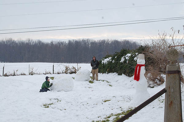My nephews Clint and his son Hayden building snowmen.<br /> <br /> Photographer's Name: Mary King<br /> Photographer's City and State: Elwood, IN
