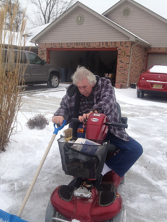 Lowell Butz (disabled Vietnam nam vet) won't let his disability get in the way of shoveling snow!<br /> <br /> Photographer's Name: Pam Butz<br /> Photographer's City and State: Anderson, IN