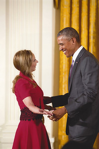 Rebecca holding hands with Barack