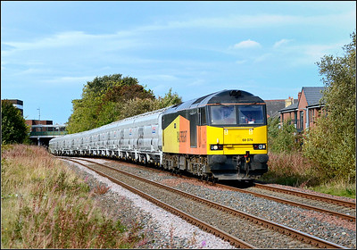 2018 09 25.60076 on the 13.58 Lynemouth p.s.-Tyne C. Terminal empty biomass hoppers passes the former Ashington railway station at Green Lane.