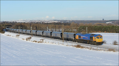 2010 12 08.66720 heads through the snow at Plawsworth on a Tyne Dock-Drax biomass working.