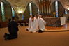 Kneeling before the Eucharist