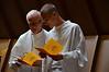 Fr. John Czyzynski and Justin Krenke (SCJ candidate) go over last minute details.