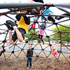 Record-Eagle/Tessa Lighty <br /> Students swing on playground equipment at Kingsley Elementary School on Tuesday. The number of kindergarteners enrolled at the school this year jumped from 114 to 130, prompting them to create makeshift classrooms.