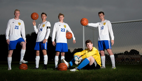 Record-Eagle/Tessa Lighty <br /> From left to right, Denver Cade, Brock Beeman, Ridge Beeman, Joey Weber and Austin Harris stand on the soccer field at Buckley High School, holding basketballs. The five are starting players on both the soccer team and the basketball team.