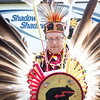 Record-Eagle/Tessa Lighty <br /> Robin Hassinger, of Cassopolis, Michigan, prepares to put on his regalia before the Grand Traverse Band of Ottawa and Chippewa Indians Traditional Pow Wow in Peshawbestown on Saturday, August 19, 2017. This was Hassinger's first year dancing in this Pow Wow, but has been participating in others for 30 years.