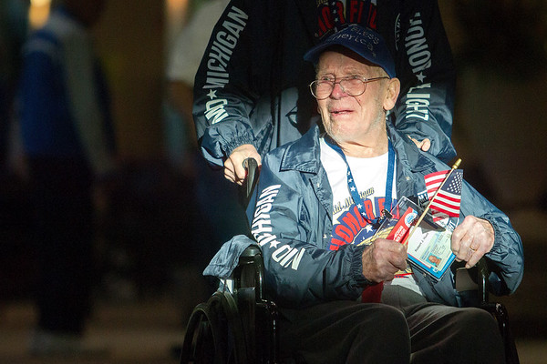 Record-Eagle/Tessa Lighty <br /> Robert Hunt is pushed in a wheelchair through the line of people holding American flags at Cherry Capital Airport in Traverse City on Wednesday, September 13, 2017. Hunt is one of many veterans traveling to Washington, D.C. to visit the war monuments for the annual Mid-Michigan Honor Flight.