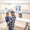 Record-Eagle/Jan-Michael Stump<br /> Eric Smith holds his 1 year-old son Fletcher inside their soon-to-be-finished home in Traverse City's Depot Neighborhood, a net-zero home and the last to be built in the project.