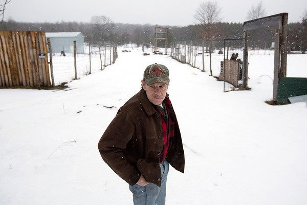 Record-Eagle/Tessa Lighty <br /> Creg Hillier stands between fields where medical marijuana crops used to grow on Wednesday, January 25, 2017. Hillier grew on Ronald Snyder's farm off Cinder Road in Beulah and was arrested and is serving a year-long probation for drug-related crimes.
